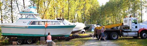 Bluefin's second electric boat conversion, a 1972 Sport-fisher Cruiser Tollycraft about to be towed.