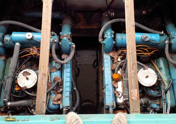 Chrysler V8's sitting in oily bilge water before removal.